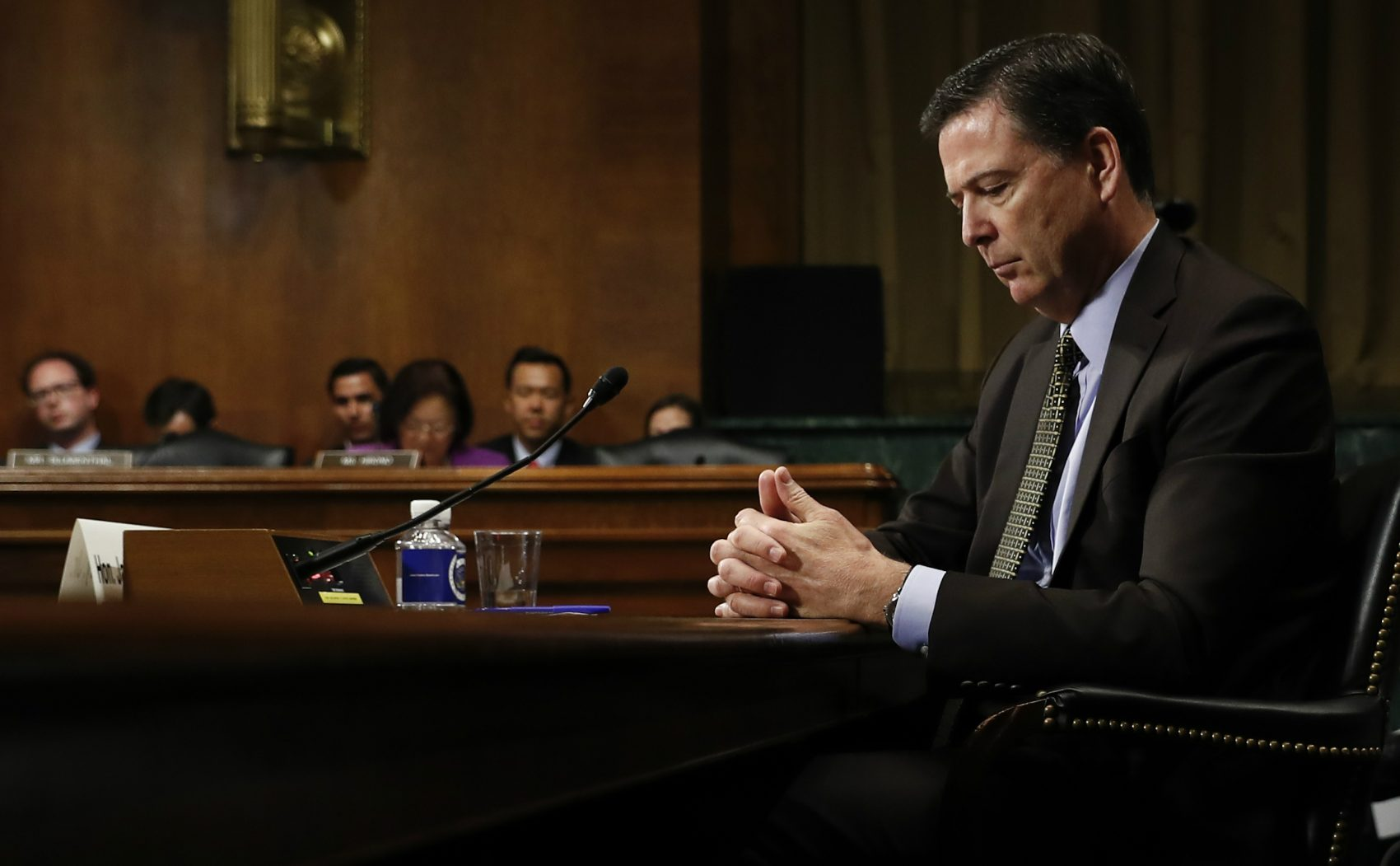 Congressional Republicans must confront whether they are willing to defend a corrupt president, or the institutions of American democracy, writes Steve Almond. Pictured: On Wednesday, May 3, 2017, then-FBI Director James Comey pauses as he testifies on Capitol Hill before a Senate Judiciary Committee hearing. President Donald Trump abruptly fired Comey on May 9. (Carolyn Kaster/AP)