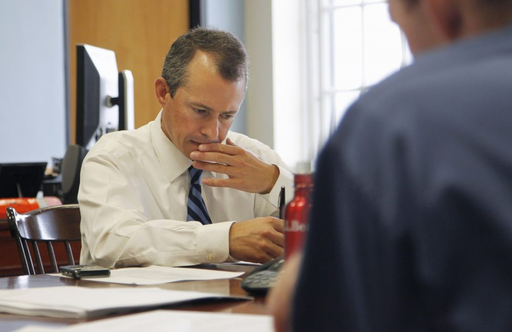 In 2011, then-state Secretary of Finance Jay Gonzalez, left, meets with his budget team at the State House. Gonzalez is now mounting a campaign for governor. (Steven Senne/AP)