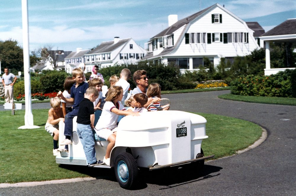 President John F. Kennedy drives his nieces and nephews around the lawn in a golf cart on Hyannis Port, Massachusetts. (Courtesy Robert Knudsen/White House Photographs/JFK Library)