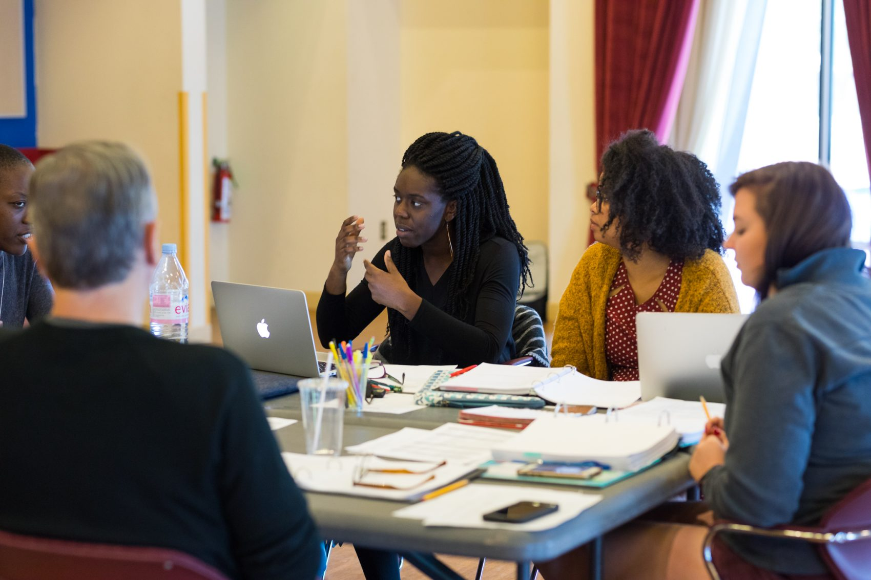 """Obehi Janice working on her play """"Ole White Sugah Daddy"""" with dramaturg Phaedra Michelle Scott and others. (Courtesy Maggie Hall Photography)"""