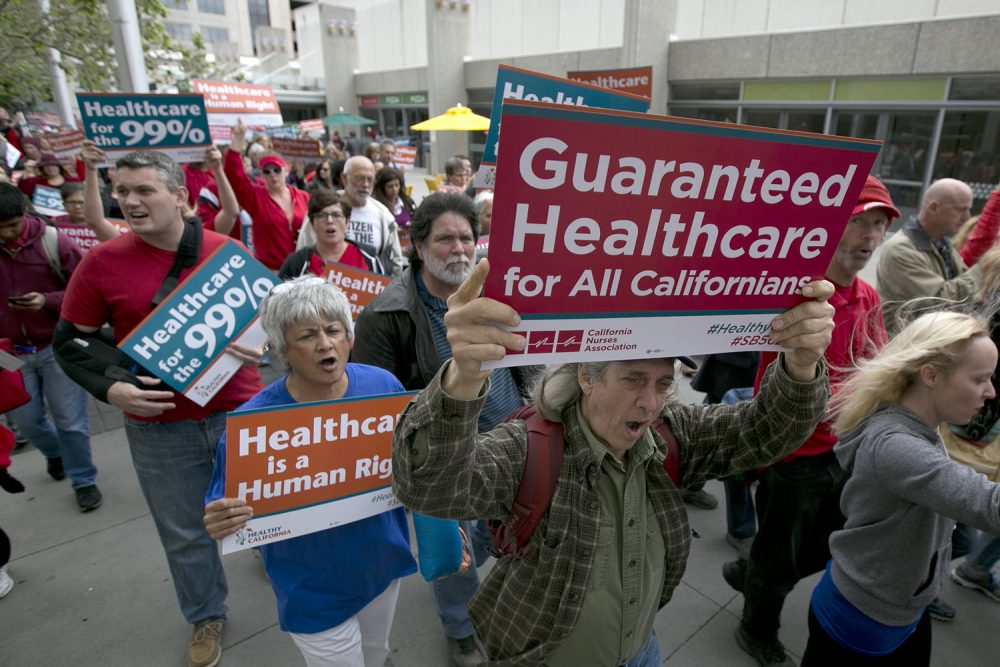 Supporters of single-payer health care march to the Capitol April 26, 2017, in Sacramento, California. (Rich Pedroncelli/AP)
