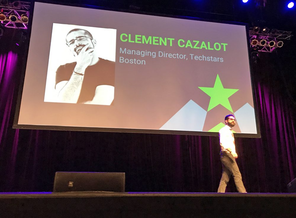 "Clement Cazalot, the newly named managing director for Techstars Boston, speaks Wednesday during ""demo day"" for the accelerator's 2017 class. (Asma Khalid/WBUR)"