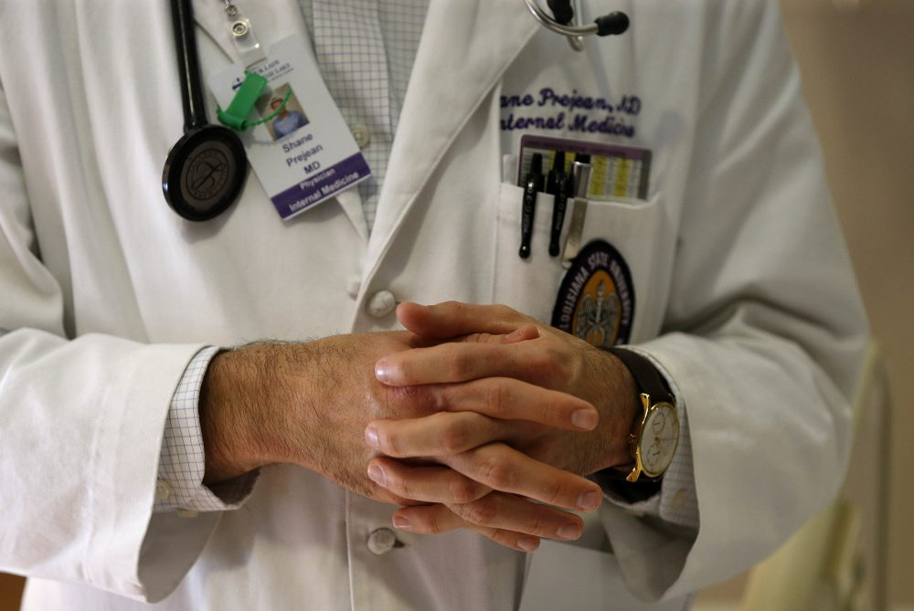 Doctors across the country are suffering from the effects of professional burnout. (Gerald Herbert/AP)