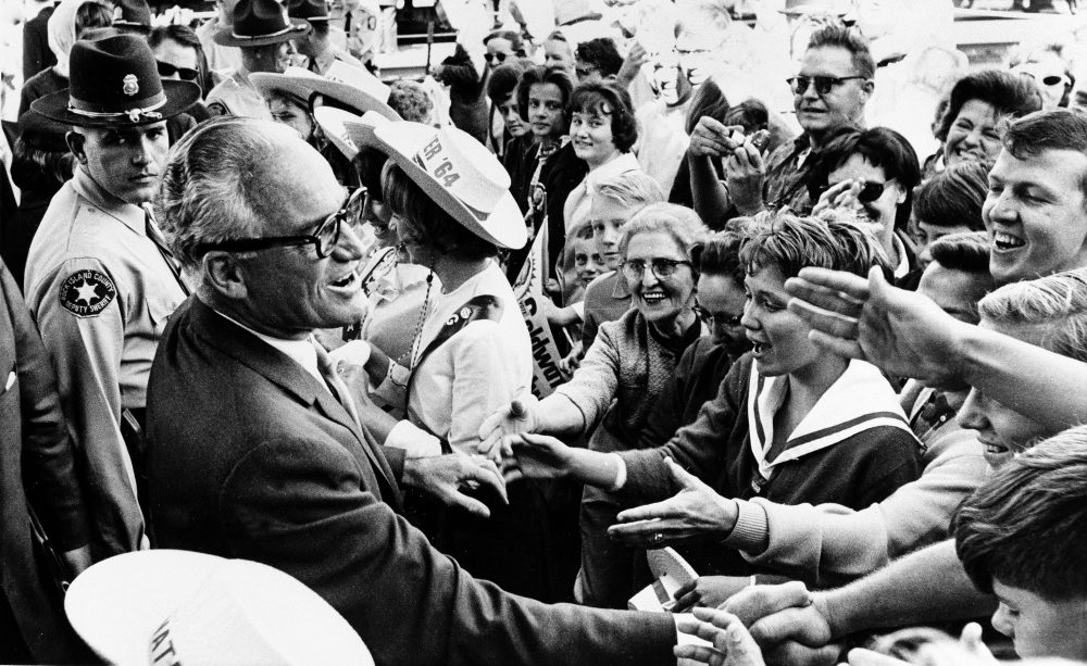 Republican presidential candidate Barry Goldwater greets supporters during a whistle-stop tour of Rock Island, Illinois, Oct. 3, 1964. (Henry Burroughs/AP)