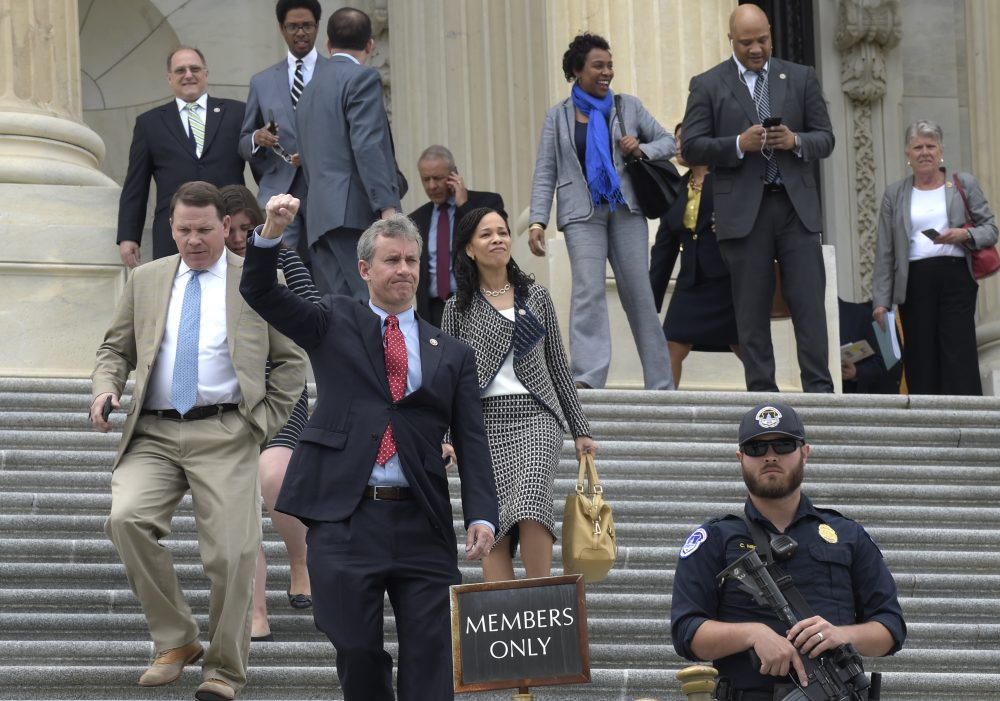 Not proposing an alternate health care bill will leave Democrats looking even more out-of-touch with the concerns of ordinary people, writes Miles Howard. Pictured: Rep. Matt Cartwright, D-Pa., responds to the protesters nearby as he and other Republican and Democratic House members walk down the steps of the Capitol in Washington, Thursday, May 4, 2017, after the Republican health care bill passed in the House. (Susan Walsh/AP)