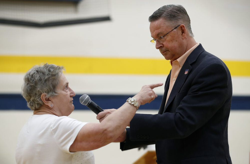 Marcia Kupka, of Clutier, Iowa, asks Rep. Rod Blum, R-Iowa, a question during a town hall meeting, Thursday, May 11, 2017, in Marshalltown, Iowa. (Charlie Neibergall/AP)