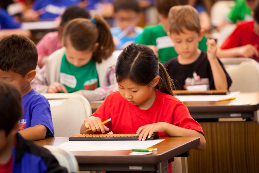 The truth is that traditional report cards rarely provide accurate assessments of student learning, writes Mike Kalin. (DoDEA Pacific/Flickr)