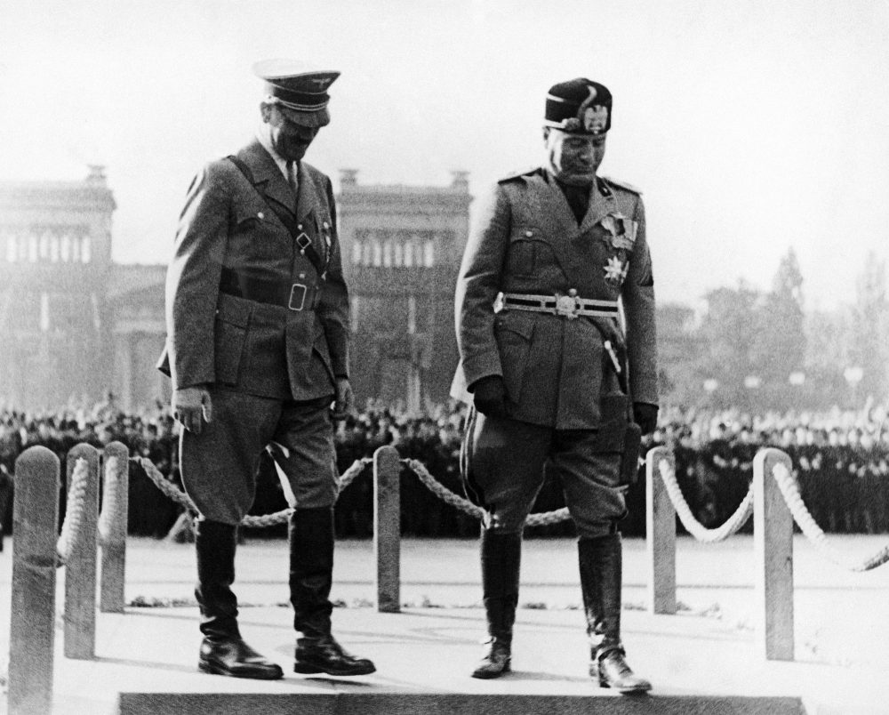 Chancellor Adolf Hitler of Germany, left, welcomes Premier Benito Mussolini of Italy to Munich, Germany, Sept. 25, 1937, during a visit by Il Duce. (AP Photo)