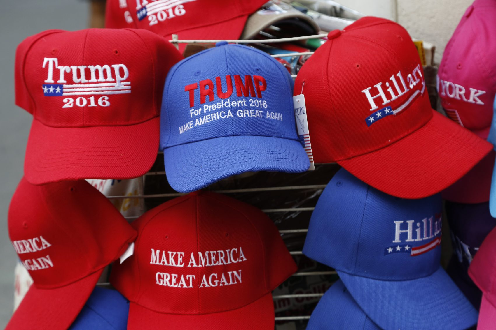 After all, we have at least three and a half more years of this administration, and that's a lot of tweets, write Jason Jay and Gabriel Grant. Pictured: Hats displaying support for  presidential candidates Donald Trump and Hillary Clinton in August 2016. (Mark Lennihan/AP)