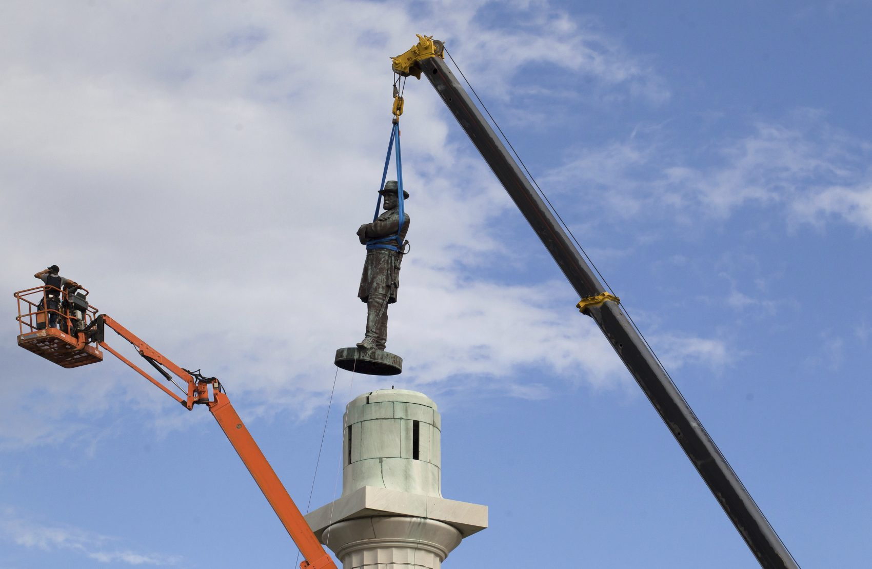 Good for news for New Orleans. But how should we deal with such sinful remainders of slavery's past in the celebrated precincts of Boston? asks Kevin C. Peterson. Pictured: A statue of Confederate General Robert E. Lee is removed from Lee Circle Friday, May 19, 2017, in New Orleans. (Scott Threlkeld/AP)