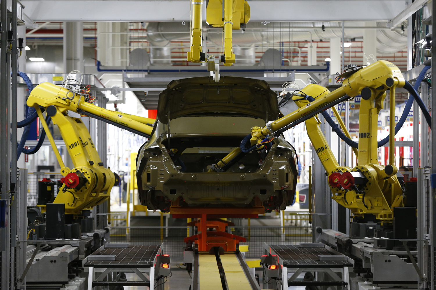 In this March 14, 2014 file photo, automated robots build a 2015 Chrysler 200 at the Sterling Heights Assembly Plant in Sterling Heights, Mich. (AP Photo/Paul Sancya, File)