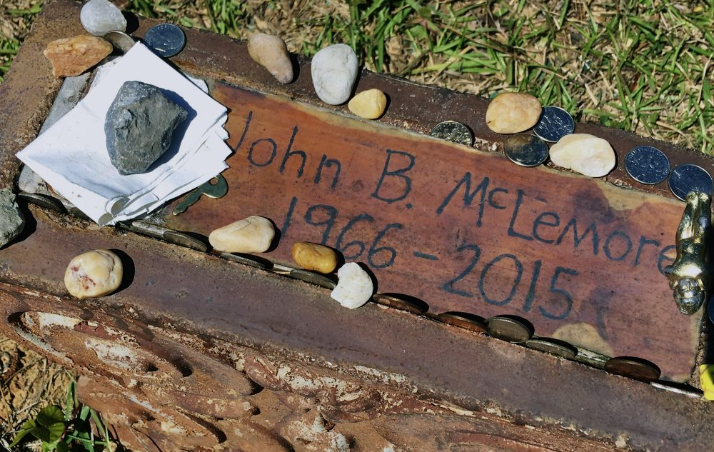One of the implicit messages in the popular podcast is that John B. McLemore's suicide was inevitable, writes Karen Seif. But it is possible that mental health intervention could have saved his life. Pictured: McLemore's grave in central Alabama. (Jay Reeves/AP)