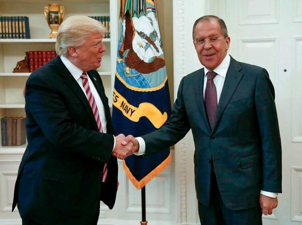 President Trump shakes hands with Russian Foreign Minister Sergey Lavrov at the White House on May 10, 2017.  (Russian Foreign Ministry Photo/AP)