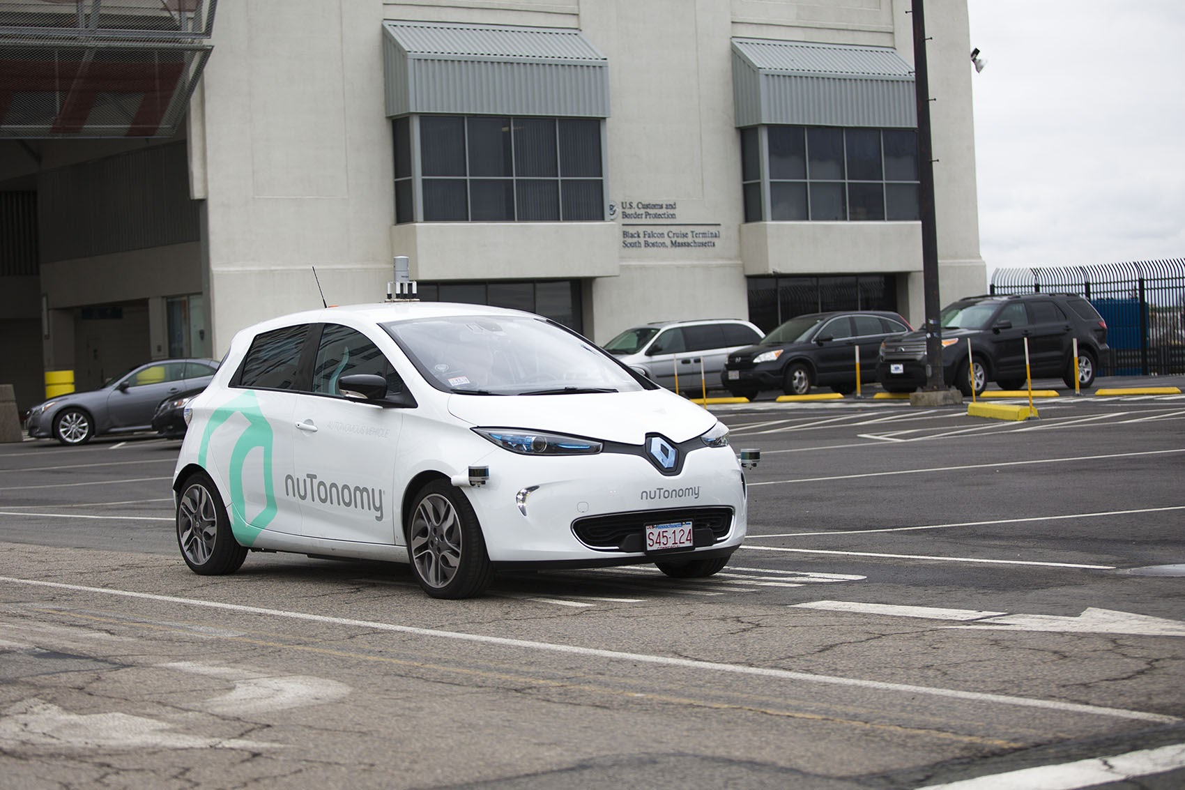 With a driver in the front seat, a nuTonomy's self-driving vehicle is tested on Black Falcon Avenue in Boston's Seaport District. (Jesse Costa/WBUR)