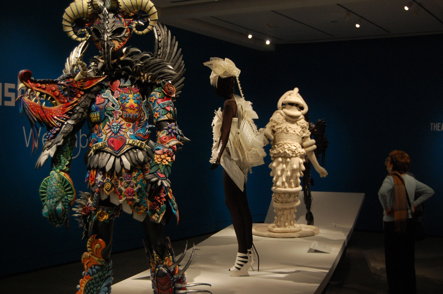 """Inkling"" (at left) by Gillian Saunders at Peabody Essex Museum's exhibit of ""WearableArt."" (Greg Cook/WBUR)"