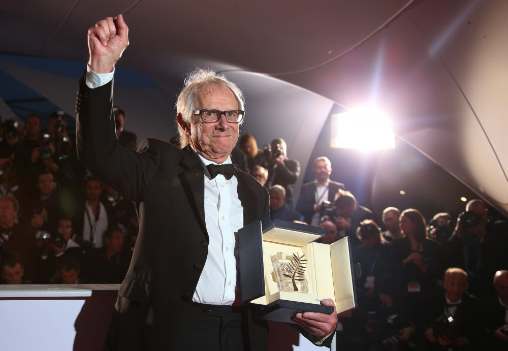"""Director Ken Loach poses for photographers with the Palme d'Or for his film """"I, Daniel Blake,"""" following the Cannes Film Festival in 2016. (Joel Ryan/AP)"""