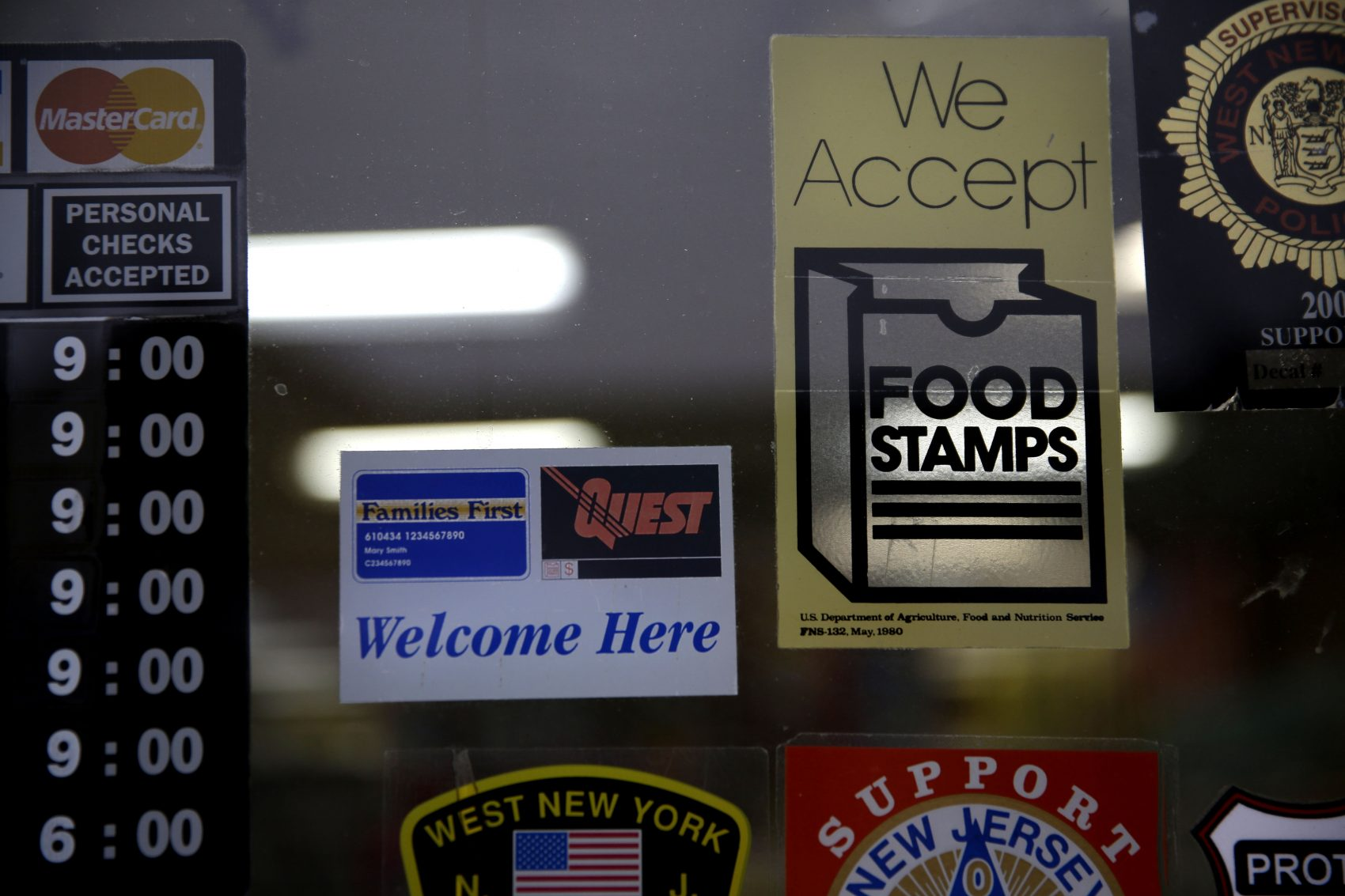 A supermarket displays stickers indicating they accept food stamps in West New York, N.J., Monday, Jan. 12, 2015. (Seth Wenig/AP)