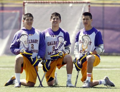 Miles (left) and Lyle (right) along with their cousin Ty at the University of Albany in 2014. (Mike Groll, File/AP)