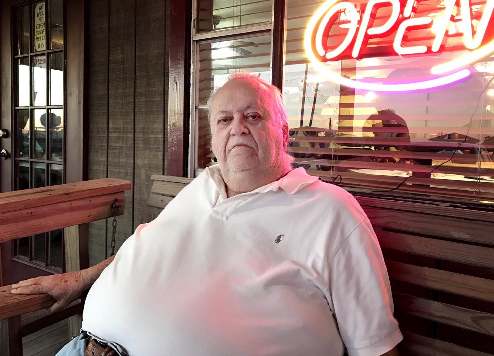 Harris Cheramie owns the Leeville Seafood restaurant. He says routine flooding and a downturn in the oil and gas industry have hurt his business. (Peter O'Dowd/Here & Now)