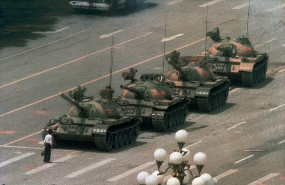 A Chinese man stands alone to block a line of tanks heading east on Beijing's Cangan Blvd. in Tiananmen Square on June 5, 1989. (Jeff Widener/AP)
