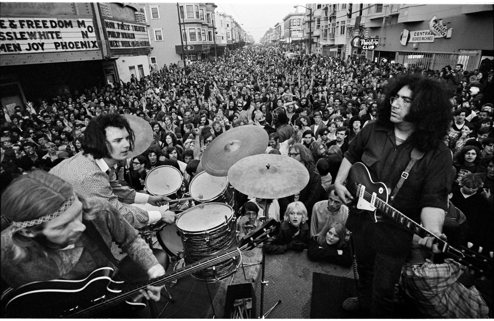 The Grateful Dead performing on Haight Street March 3, 1968. Left to right: Phil Lesh, Bill Kreutzmann and Jerry Garcia. (Courtesy Jim Marshall Photography LLC)