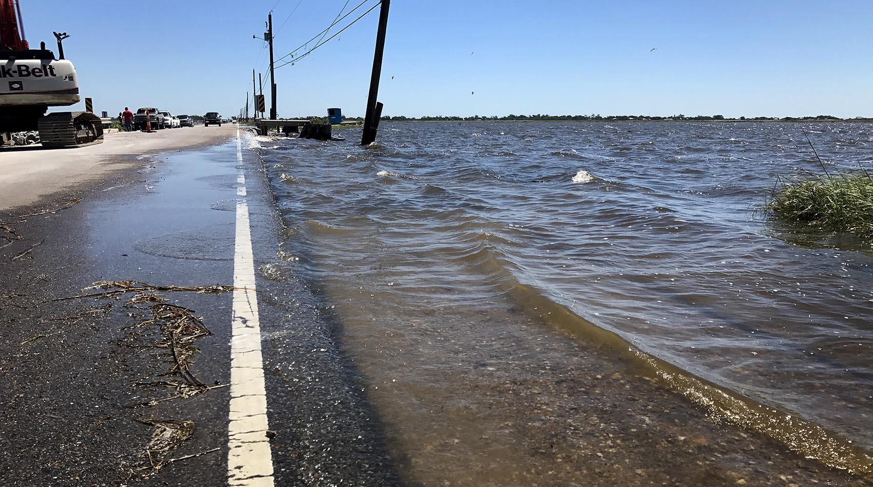 The road leading to Isle de Jean Charles, La., is known to flood in perfect weather. (Peter O'Dowd/Here & Now)