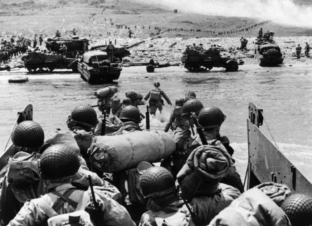American assault troops and equipment landing on Omaha Beach on the northern coast of France on D-Day. (Fox Photos/Getty Images)