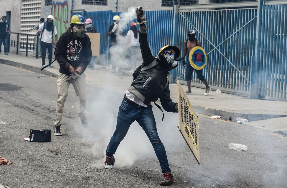 Opposition activists clash with riot police during a demonstration against President Nicolas Maduro's government in Caracas, on June 5, 2017. (Juan Barreto/AFP/Getty Images)