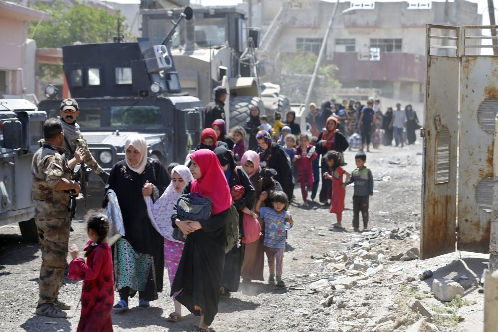 Iraqis leave the Zanjili neighbourhood in west Mosul on June 3, 2017, during the ongoing offensive by security forces to retake the city from Islamic State group fighters. (Karim Sahib/AFP/Getty Images)
