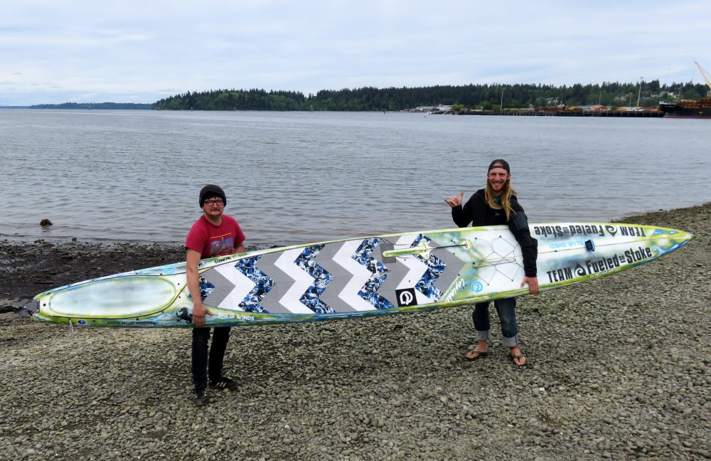 Erdogan Kirac, left, and Luke Burritt of Bellingham, Wash., are planning to compete in the Race to Alaska on twin boards, including this one. (Tom Banse/Northwest News Network)