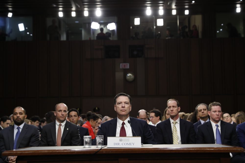 Former FBI Director James Comey listens to the committee chairman at the beginning of the Senate Intelligence Committee hearing on Capitol Hill, Thursday, June 8, 2017, in Washington. (Alex Brandon/AP)