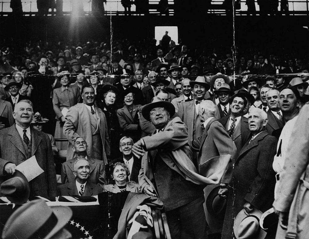 On Sept. 2, 1945, President Harry Truman (center) became the first president since the start of World War II to attend a Washnigton Nationals baseball game. Here, Truman is pictured at Griffiths Stadium in Washington in 1949, where the New York Yankees are playing the Senators. (Keystone/Hulton Archive/Getty Images)