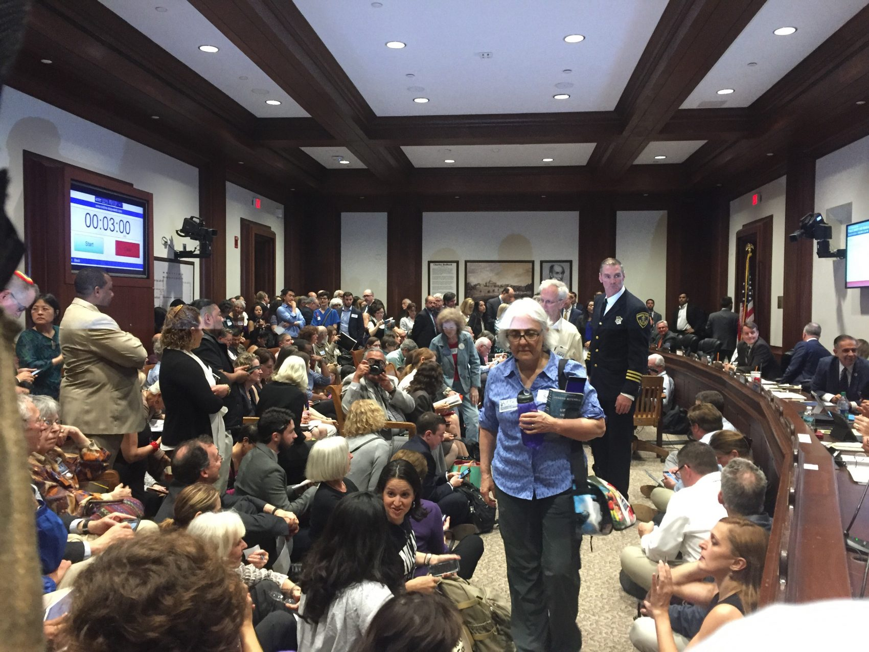 Bills that would limit the state's role in federal law enforcement drew a large crowd to the State House for an uncommon Friday hearing. (Colin A. Young/State House News Service)