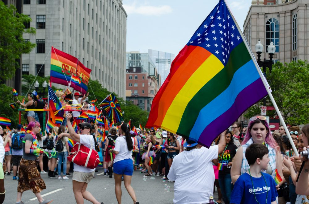 """This year's slogan for Pride was """"Stronger Together"""" -- and that celebratory, but determined, feeling filled the parade route. (Elizabeth Gillis/WBUR)"""