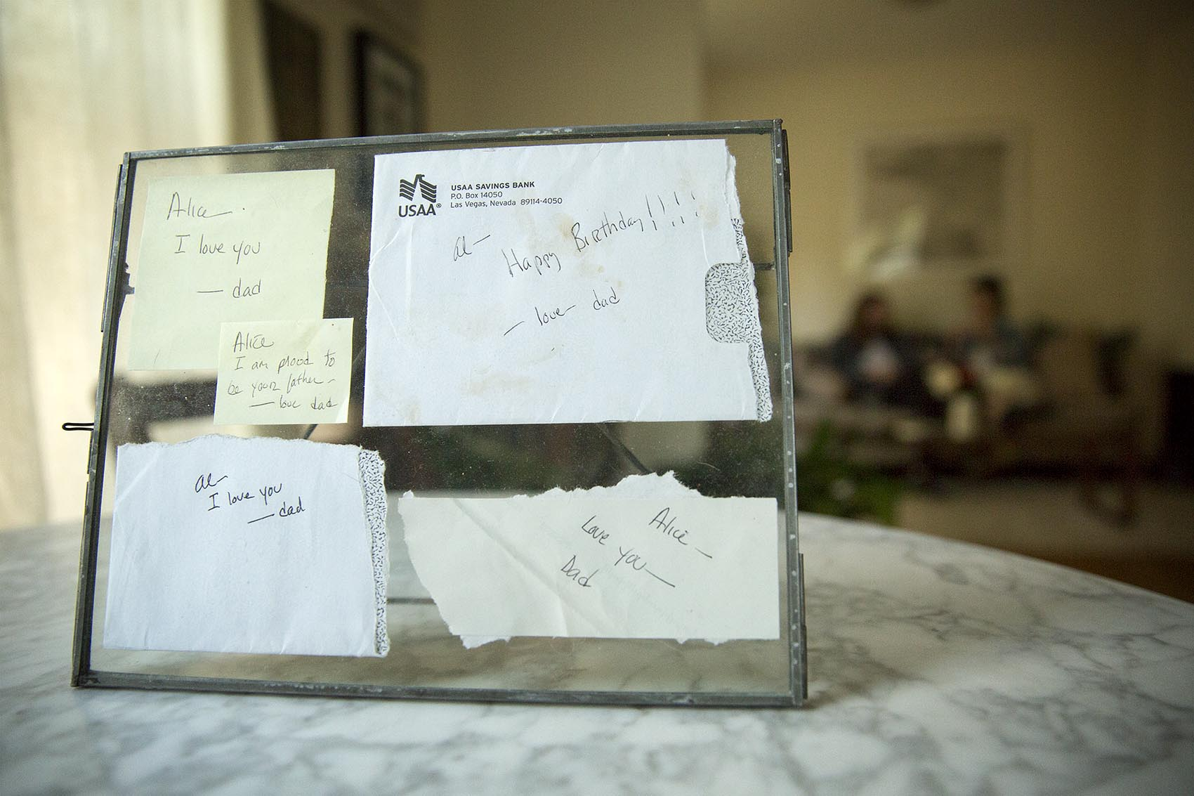 Framed notes from Arpy Saunders to his daughter Alice. (Robin Lubbock/WBUR)