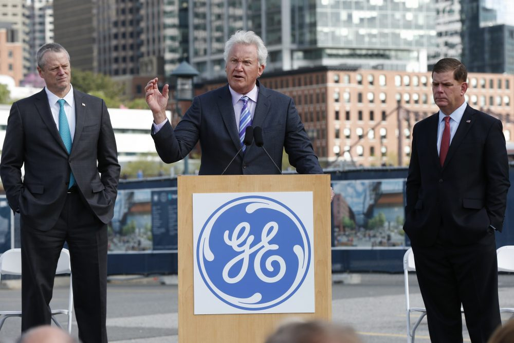 General Electric CEO Jeff Immelt speaks during a groundbreaking ceremony at the site of GE's new headquarters as Massachusetts Gov. Charlie Baker, left, and Boston Mayor Marty Walsh look on in Boston on May 8. (Michael Dwyer/AP)