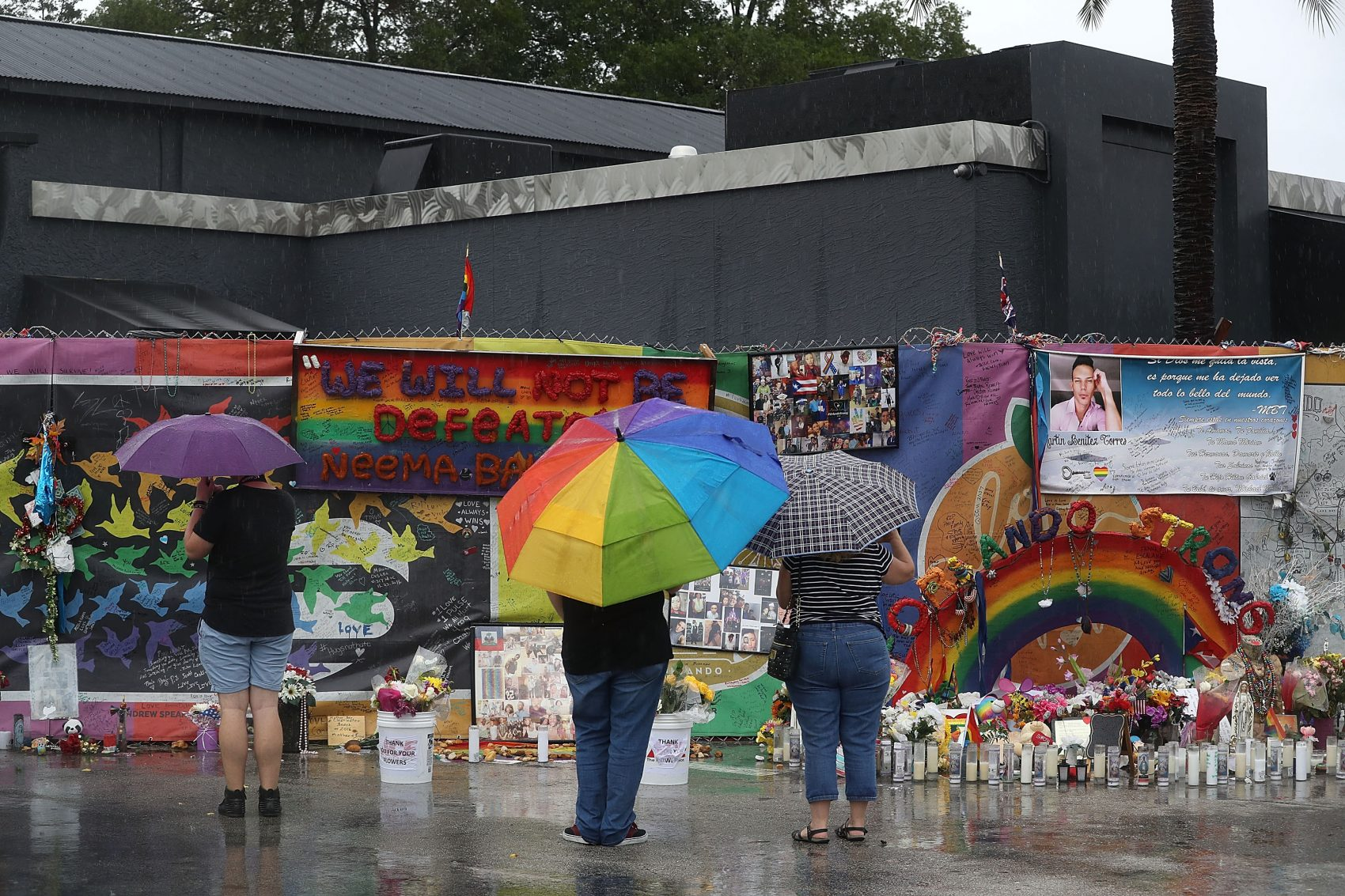 People visit the memorial to the victims of the Pulse nightclub shooting one day before the one-year anniversary of the shooting on June 11, 2017, in Orlando. (Joe Raedle/Getty Images)