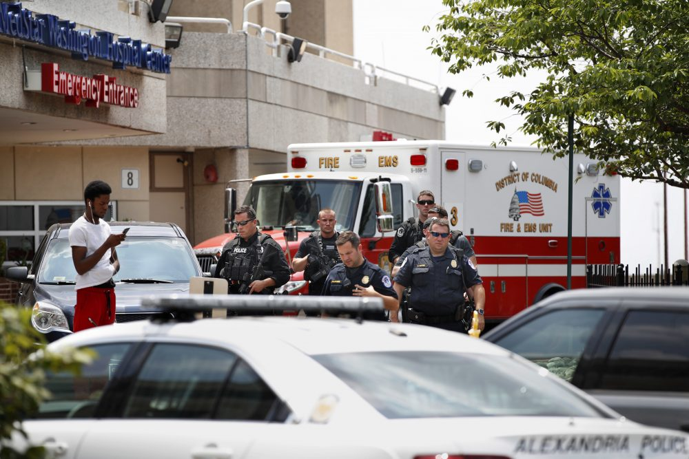 Capitol Hill Police leave the emergency entrance at MedStar Washington Hospital Center in Washington, Wednesday, June 14, 2017, where House Majority Leader Steve Scalise of La. was taken after being shot in Alexandria, Va., during a Congressional baseball practice. (Jacquelyn Martin/AP)