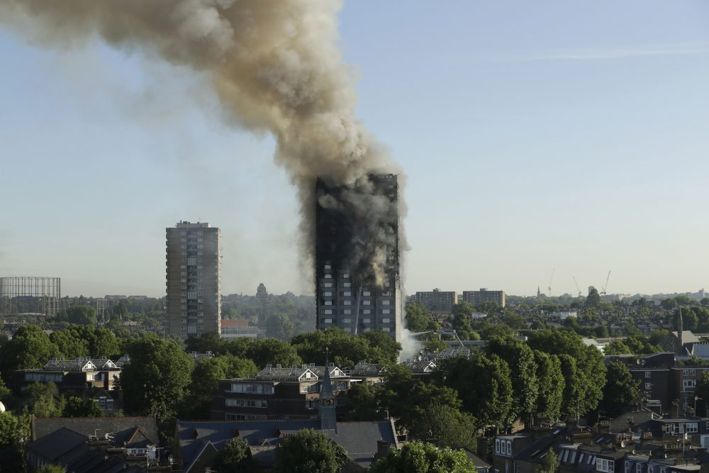 Smoke rises from a high-rise apartment building on fire in London, Wednesday, June 14, 2017. (Matt Dunham/AP)