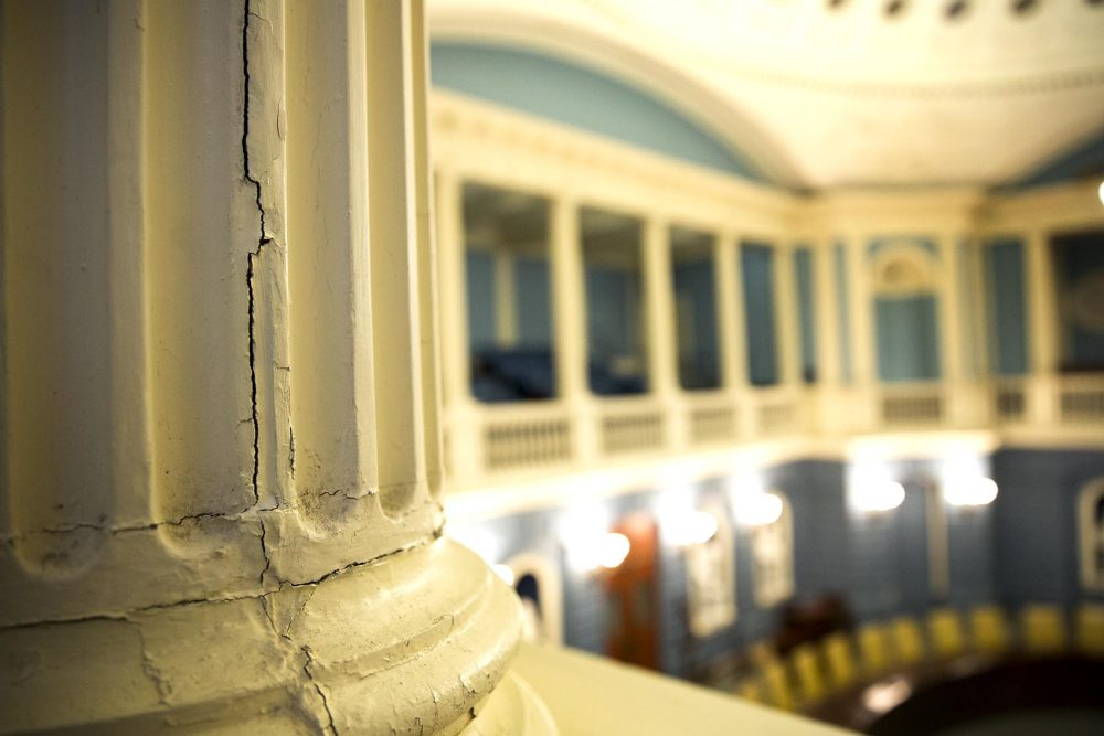 A crack runs down the side of one of the balcony columns in the Massachusetts State House's Senate Chamber. (Robin Lubbock/WBUR)