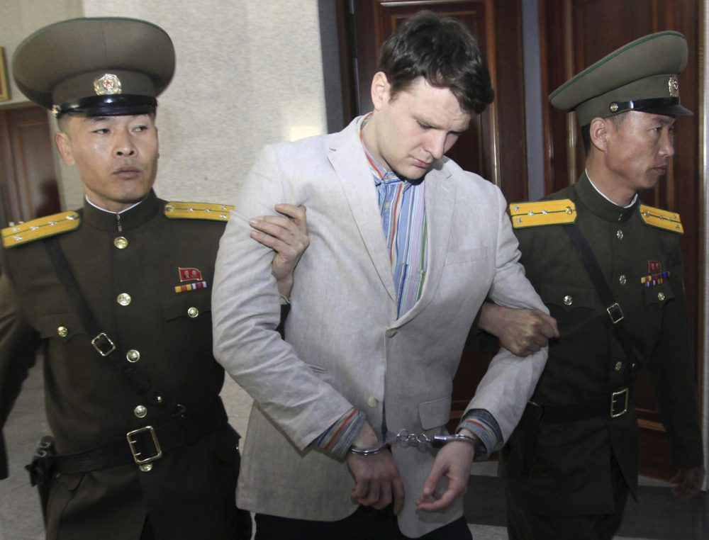 In this March 16, 2016, file photo, American student Otto Warmbier, center, is escorted at the Supreme Court in Pyongyang, North Korea. Warmbier, whose parents say has been in a coma while serving a 15-year prison term in North Korea, was released and returned to the United States Tuesday, June 13, 2017, as the Trump administration revealed a rare exchange with the reclusive country. (Jon Chol Jin/AP)