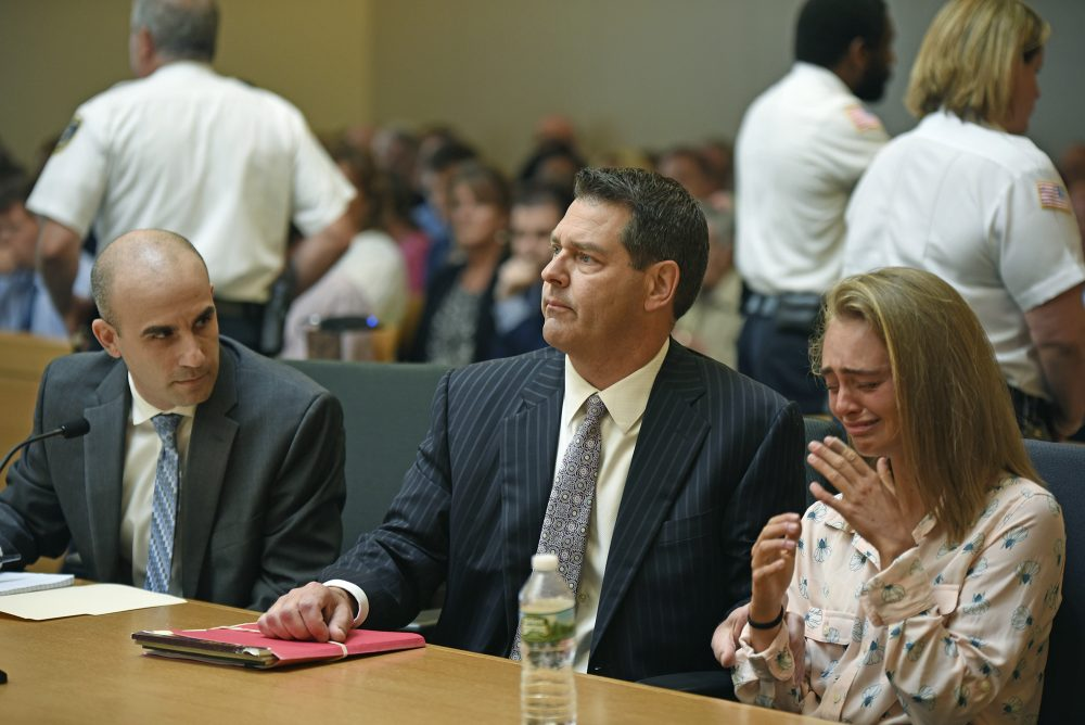 Michelle Carter, right, seated with her attorneys Cory Madera, left, and Joseph Cataldo reacts as she listens to Judge Lawrence Moniz before he finds her guilty Friday of involuntary manslaughter in the suicide of Conrad Roy III. (Glenn C.Silva/Fairhaven Neighborhood News, Pool)