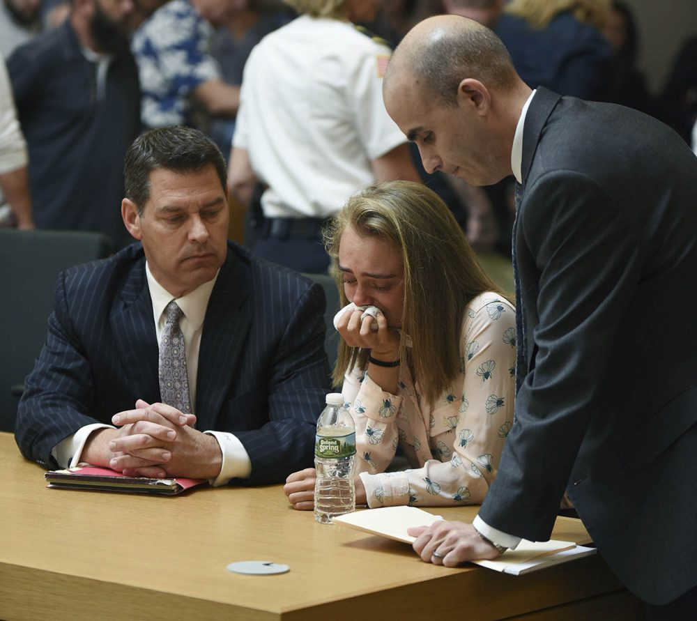 Michelle Carter cries while flanked by defense attorneys Joseph Cataldo, left, and Cory Madera, after being found guilty of involuntary manslaughter in the suicide of Conrad Roy III. (Glenn C.Silva/Fairhaven Neighborhood News, Pool)