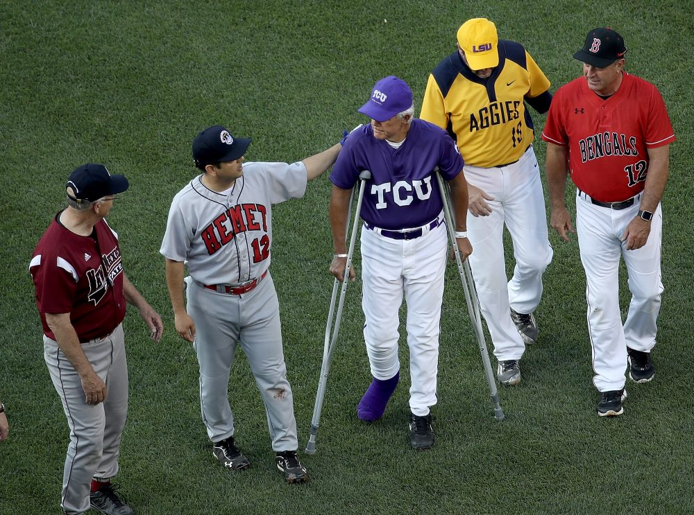 Rep. Roger Wiliams (R-TX) greets fellow members of congress as he walks with crutches before the start of the Congressional Baseball Game at Nationals Park on June 15, 2017, in Washington, D.C. (Win McNamee/Getty Images)