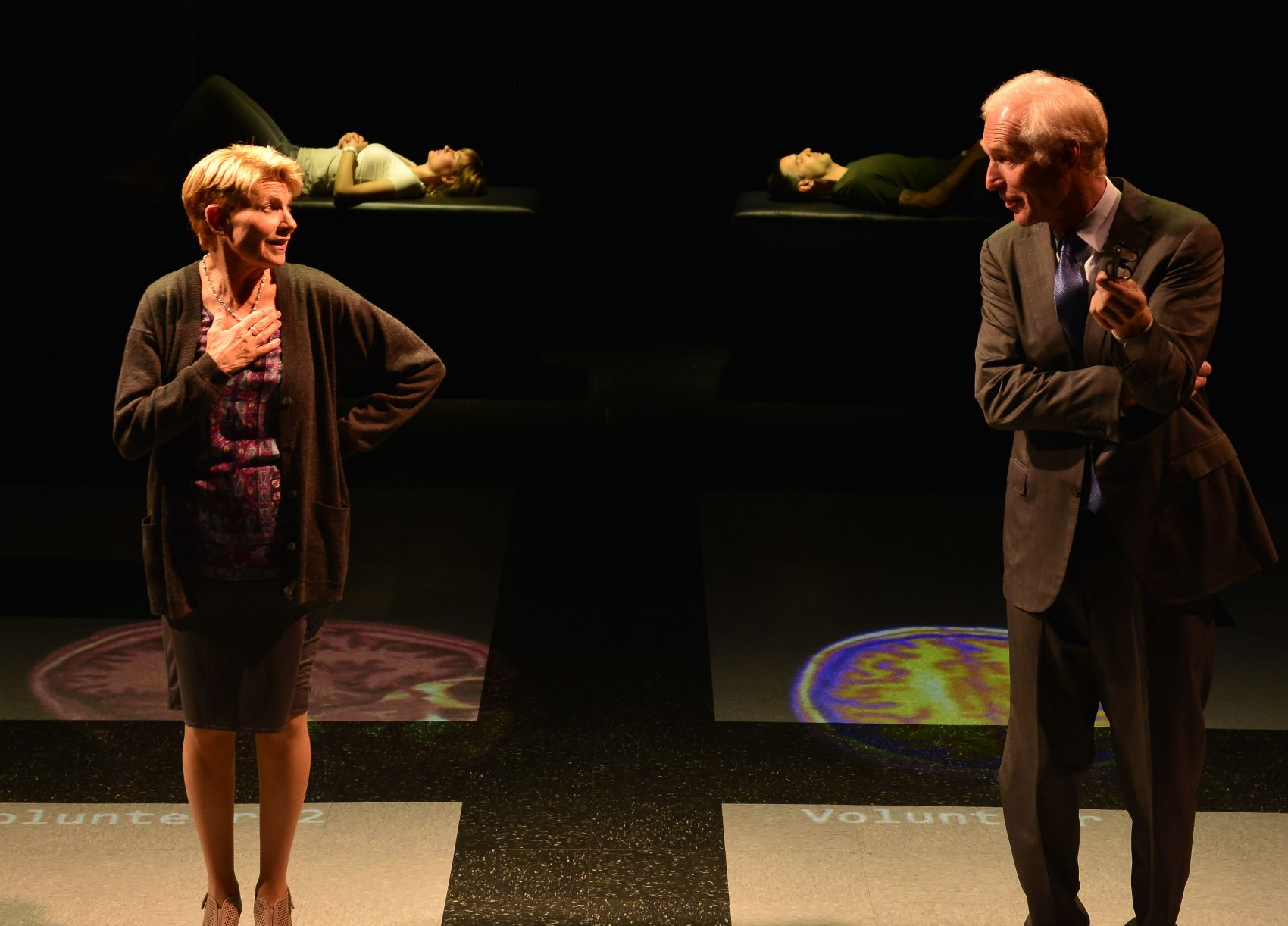 """Dr. Lorna James (Lindsay Crouse) and Dr. Toby Sealey (Brad Hall), with Connie (Susannah Hoffman) and Tristan (Mickey Solis) in the background in """"The Effect."""" (Courtesy Gary Ng/Gloucester Stage)"""