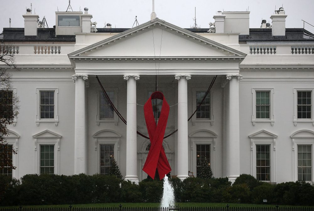 A red ribbon is displayed on the North Portico of the White House to recognize World AIDS Day in 2015. (Mark Wilson/Getty Images)