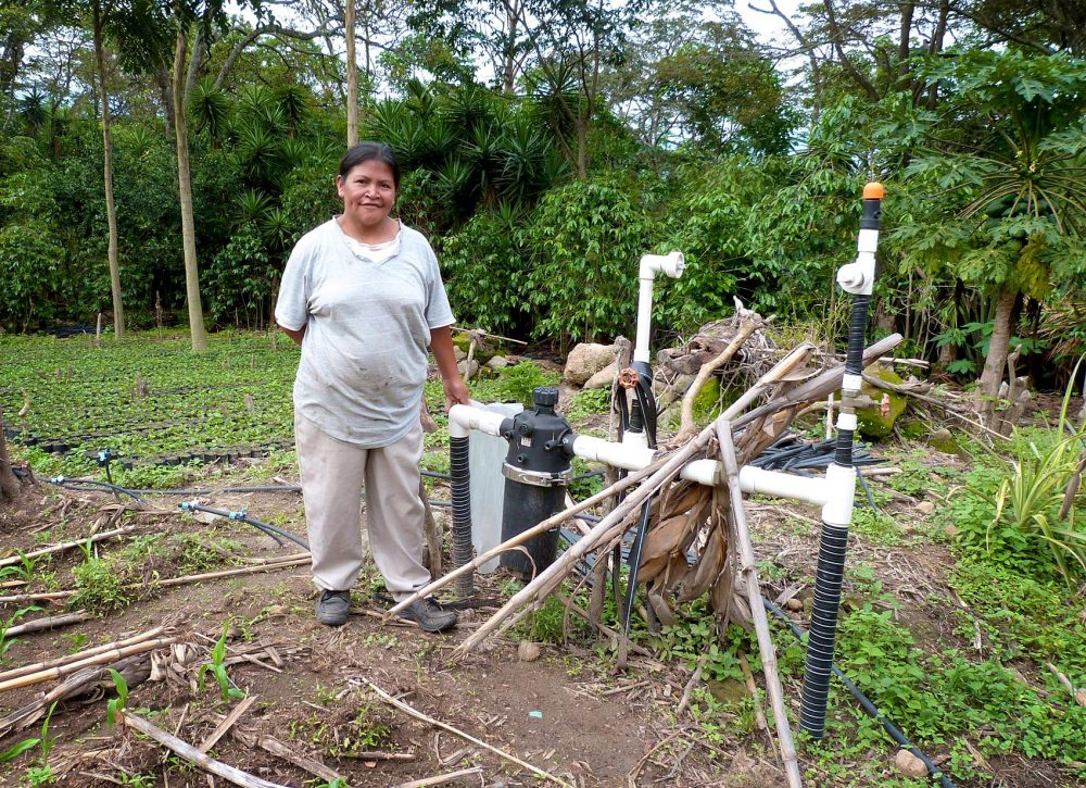 Dilcia Garcia beside the irrigation system that was installed with USAID funding. President Trump's new budget proposal would discontinue the development aid money for her project and others like it. (Karyn Miller-Medzon/Here & Now)