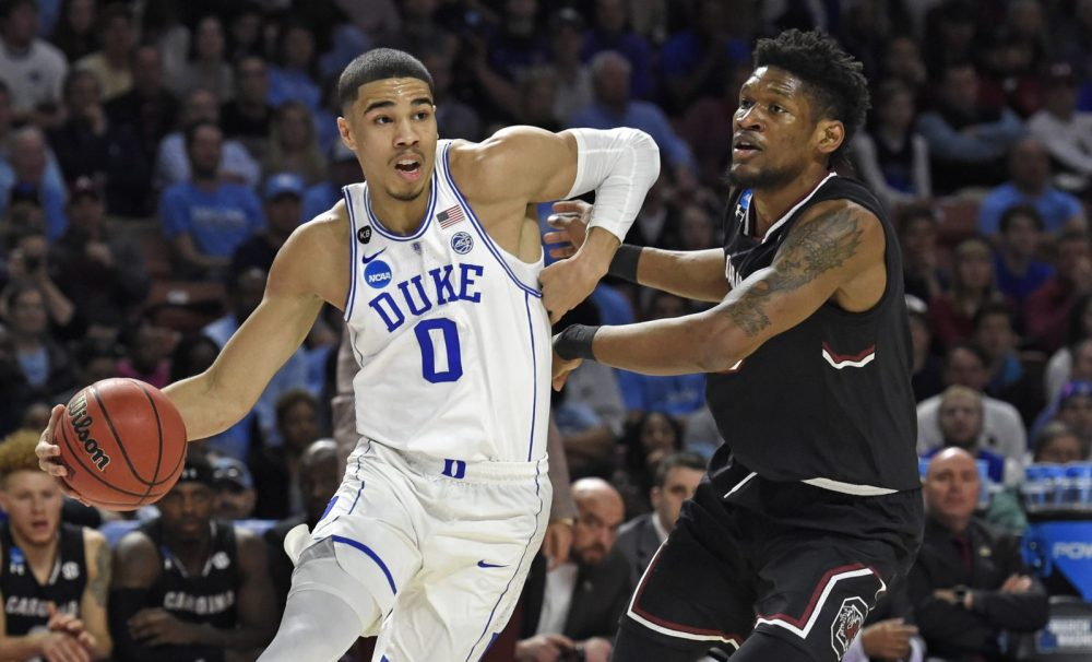 Jayson Tatum, as a student at Duke in March 2017, drives past South Carolina's Chris Silva during a NCAA game. (Rainier Ehrhardt/AP)