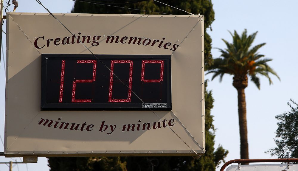 A local temperature sign reads 120-degrees as temperatures climb to near-record highs Tuesday, June 20, 2017, in Phoenix. (Ross D. Franklin/AP)