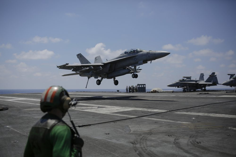 A fighter jet lands on the USS George H.W. Bush aircraft carrier on Thursday, June 22, 2017 in the Mediterranean Sea. F18 fighter jets launch multiple times a day from the carrier bombing the Islamic State positions in Iraq and Syria. (Bram Janssen/AP)